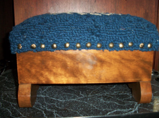 Hooked wool blue cat footstool sideview