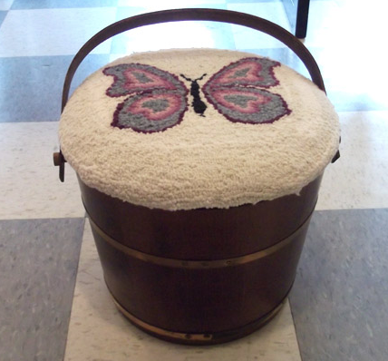 Hooked wool storage stool with butterfly